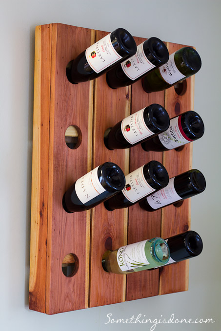 This style of wine rack is called a riddling rack. It's how wine bottles  were stored when making sparkling wine  the wine bottles were turned and  the angle ...